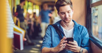 Young man checking messages on his smart phone