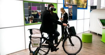 Berlin, Germany - March 10, 2016: A visitor wearing VR goggles while riding a bicycle displayed in the Radland booth during the ITB Berlin 2016, one of Germany's biggest travel fairs held in Messe Berlin in Berlin, Germany.